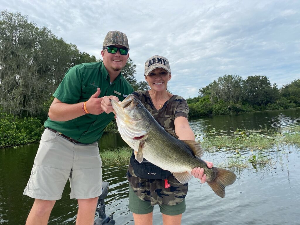 Robin Tiller of Canton, Georgia literally rocked the boat and the record book when she reeled in this 8.8lb bass. Nice catch Robin! . . . #streamsong #streamsongresort #bassfising #monsterbass #lovefl #fishflorida #freshwaterfish #golfresort #golfing #getoutside
